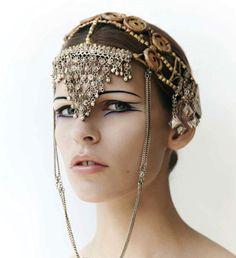 Headdress, interesting make-up.