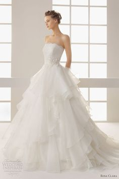 Two by Rosa Clará 2013 bridal collection.  Dehesa strapless gown with tiered organza skirt and lace bodice.