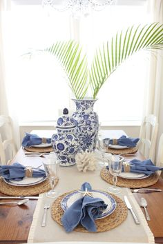 Hoping everyone had a lovely weekend. I am back today with a pretty blue and white coastal table setting from our dining room! I just love setting a pretty table and blue is one of my favorite colors to decorate with! Relaxed coastal touches like the seag Dining Table Placemats, Blue Placemats, Dining Room Table Decor, Deco Table, Decoration Table, Dining Rooms, Decorate Dining Tables, White Table Settings, Setting Table