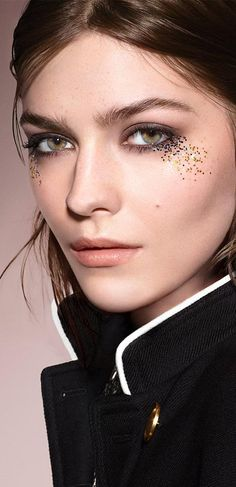 The Runway Make-up Look. Dark, smokey eyes enhanced with iridescent glitter, set…