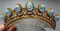 This is a French Empire Josephine comb, c. 1860, with beautiful large brass galleries and blue-and-white glass cameos.