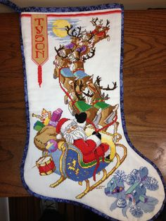 """This is the first stocking I ever made, in fact the first counted cross stitch I ever did.  I wanted to make something that the kids wouldn't just throw away someday.  I liked this pattern and when my daughters saw their choices, they picked others, but my son shrugged and said this was fine! This is from a book """"The Stockings Were Hung"""", a Leisure Arts Publication, Christmas Remembered, Book 16, copyright 1998. I love this book!!!"""
