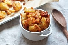 An extra special technique that involves boiling, draining, shaking, and roasting, these potatoes acquire a rough-hewn texture that serves them well in the crispiness department. They might be baked but they don't look or taste it.