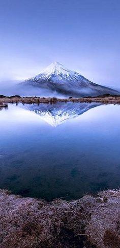 Reflection of Mount Taranaki in the Pouakai Tarns, Taranaki, Mount Egmont National Park, North Island, New Zealand...