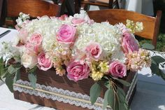 Wooden boxes filled with roses, hydrangeas, stock, eucalyptus