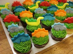 Dinosaur Cupcakes by Amanda's Caketastic Creations, via Flickr. Might do something similar, but with molded chocolate dinosaurs.