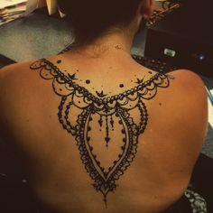 Back henna tattoo using jagua