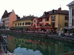 Annecy's pretty medieval buildings illuminated at dusk. A weekend to remember in Annecy, France.