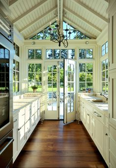 **Kitchen that is part greenhouse.  (by AOME Architects)