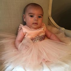 "So pretty!! Only a few weeks old and already rocking Couture #ittybittytoes  She's wearing our Princess Aisha Dress in Rose Gold  Available here: ittybittytoes.com (search ""Aisha"")"