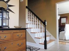 Painted our staircase rail black similar to this and it looks fantastic.  Got the idea from Pinterest.