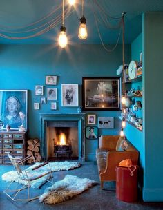 Bold blue walls in a London living room from Marie Claire Maison.
