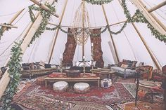 """pow wow // tent http://www.refinery29.com/brit-castanos-wedding-pictures#slide-1  """"I still can't believe how gorgeous Pow Wow made the entire reception setup,"""" says Castanos-Osborne. """"I was in complete awe. There were layers upon layers of Moroccan rugs, plush couches and chairs, poufs everywhere, cabanas that blew beautifully in the wind, and even a crochet hammock that you could take a snooze in if yo..."""