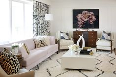 Sarah Walker originally planned on a lush green couch for her living room, but she ultimately went with a soft pink one, which fits in better with the rest of her home. Click through for more One Room Challenge reveals.