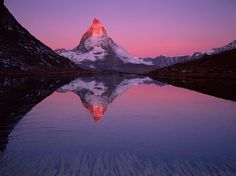 Matterhorn  Photograph by Verena Popp-Hackner, Wild Wonders of Europe    This Month in Photo of the Day: Nature and Weather Photos    Radiant at sunrise, the Matterhorn towers over Riffel Lake near Zermatt, Switzerland.