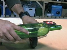 How-To: Cut a Wine Bottle in 30 Seconds  A better technique than others - just some minor changes in how it's done - use a glass cutter to score a line around the bottle, then pour boiling water on the score line, run cold water on the bottle, and repeat. The top falls off and the cut is perfect and smooth - no jagged edges!