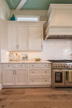 white kitchen cabinets + turquoise ceiling | Calusa Construction