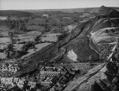 Debris field of mine waste which collapsed into the Welsh village of Aberfan on 21 October Rain-saturated colliery spoils liquified destroying houses and inundating classrooms at Pantglas Junior School. 116 children and 28 adults died. Uk History, Family History, Village Photos, Lest We Forget, Slums, South Wales, Orange County, Geology, Old Photos