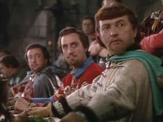 (L-R) Melville Cooper, Basil Rathbone, and Claude Rains as the Sheriff of Nottingham, Sir Guy of Gisbourne, and Prince John in The Adventures of Robin Hood (1938)