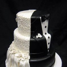 "This is a nice wedding cake. The Bride's side is a tab larger than the grooms but the fact is this cake is more of yummy celebration of two souls joined as one, makes it better than the traditional selfish ""all about the bride. Groom? What groom?"" cake."