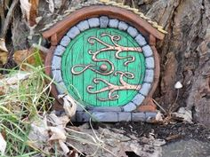 I love these magical little doors.  Who knows who I'll invite?!  Hobbit/Fairy Door by HiddenWorlds on Etsy, $35.00