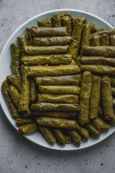 These Vegetarian Stuffed Grape Leaves are a Mediterranean classic recipe made with short grain rice, parsley, tomatoes and onions - my favorite appetizer! Armenian Recipes, Lebanese Recipes, Turkish Recipes, Greek Recipes, Fruit Recipes, Snack Recipes, Vegan Dolmas Recipe, Grape Leaves Recipe, Stuffed Grape Leaves