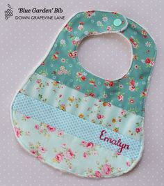 Personalised patchwork baby bib 'Blue Garden' - floral girl bib with hand embroidered name on Etsy, $18.15