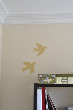 Using contact paper found at almost any store I googled for some bird silhouette patterns.   Tape the pattern onto the contact paper, cut it...