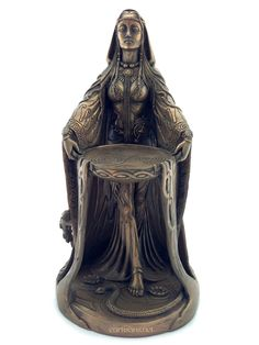 Our Danu Goddess statue comes in a bronze finish, and is absolutely beautiful! The intricate detail on the front and back are outstanding. The back of her cloak she has a tree of life inscribed along