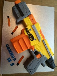 10. Impressive Nerf Birthday Cake Made from fondant. It's amazing! This is seriously the neatest Nerf Cake Ever! vcmblog Boys Nerf Birthday Party Cake, Cupcake and Cook