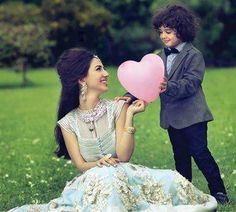 cute pic of a bride with a cute lil boy - for more follow my dulha dulhan board