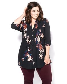 Show your girly side with this gorgeous blouse from Melissa McCarthy's collection. You'll love its fun, floral print, as well as its light, soft fabric, 3/4 sleeves and button-up front. A tie at back helps create a flawless, flattering silhouette. Wear it with a skinny pant for a look you can wear from weekday to weekend.