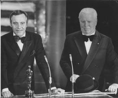 """Jack Lemmon presents Charlie Chaplin with his Oscar at the Academy Awards The Oscar was an Honorary Award for """"the incalculable effect he [Chaplin] has had in making motion pictures the art form of this century. Jack Lemmon, Charlie Chaplin, Oscar Movies, New Movies, Good Movies, Paulette Goddard, Old Hollywood Stars, Classic Hollywood, Charles Spencer Chaplin"""