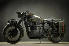 Vintage Triumph bike in army green