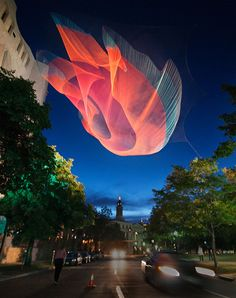 Artist Janet Echelman is known for her large-scale sculptures made from fishing net. With light directed to her art installations, the colors become vibrant at night.