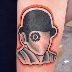 A Clockwork Orange inspired traditional tattoo on the forearm.