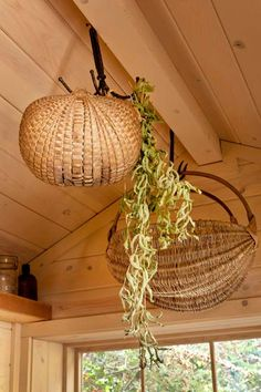 Antique hooks along the ridge beam have room for more dried herb bundles; they also come in handy for storing the big melon-shaped baskets she uses for harvesting fruit from the citrus trees she grows out back.
