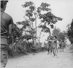 Remembering members of 3rd Battalion, 187th Infantry, 101st Airborne join local children in baseball, north of Hue, 1970. #Vietnam Veterans #VVMF Education