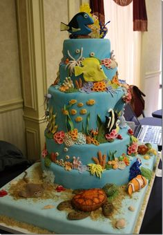 This is a finding nemo cake I made for a cake competition held in my town. It was my first cake competition and I got place. I really loved this cake! The inside of the cake lit up and the top of the cake also lit up and moved. All the fish. Cupcakes, Cupcake Cakes, 16 Cake, Finding Nemo Cake, Finding Dory, Cake Competition, Sea Cakes, Fantasy Cake, Disney Cakes