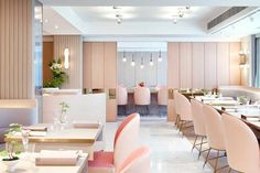 Hong Kong's new TATE Dining Room and Bar by JJA / Bespoke Architecture evokes the atmosphere of both a feminine boudoir and a stylish gallery.
