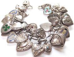 LOADED VINTAGE ANTIQUE STERLING SILVER ENAMEL JEWELED PUFFY HEART CHARM BRACELET | eBay, sold for $737.00