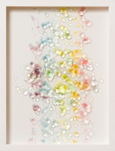 Miyuki Takenaka 1976-  artists  Born in Gifu. Resin in between layers of acrylic plates reflects light and cast its shadow on white base panel. The shadows makes different impression in different moments in time along with the soft blur made by water colors.