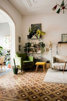 eclectic living room with orante molding and patterned tile floors in Barcelona, Spain belonging to designer Paloma Wool / sfgirlbybay
