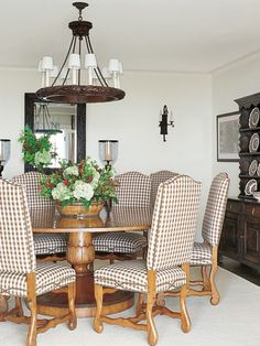 Gingham chairs surround a table in the dining room of a cozy North Carolina family retreat