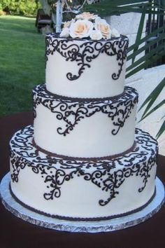 Wedding Cake with Chocolate Piping I want this except with song lyricsa!!!!!!