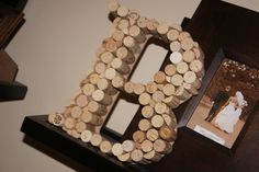 Love this neat idea to recycle wine corks into neat gift or decor for a room.  My sister has one with her initial on her mantel and it is a conversation starter for all who see it!