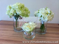Wedding flowers. Little mis-match vases of flowers have a relaxed look about them.