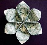 Origami Money Flower.  Link to PDF diagrams here:  http://blog.makezine.com/archive/2007/11/3_origami_flower_weekend.html.  PDF here:  http://makezineblog.files.wordpress.com/2007/11/wp_origami_ponoko.pdf