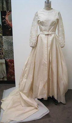 Wedding Dress  Mainbocher (American, 1890–1976).  Date: 1968. Culture: American. Medium: a,b) silk, pearl; c) silk, pearl, plastic; d) silk, plastic. Dimensions: Length at CB (a): 57 in. (144.8 cm). Length at CB (b): 85 1/2 in. (217.2 cm). Diameter (c): 7 in. (17.8 cm). Width at Bottom (d): 14 in. (35.6 cm).