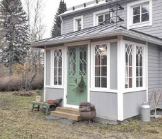 a grey wooden house exterior Norwegian House, Tiny House, Glass Porch, Swedish Cottage, Front Door Design, House Extensions, Wooden House, Facade House, Scandinavian Home
